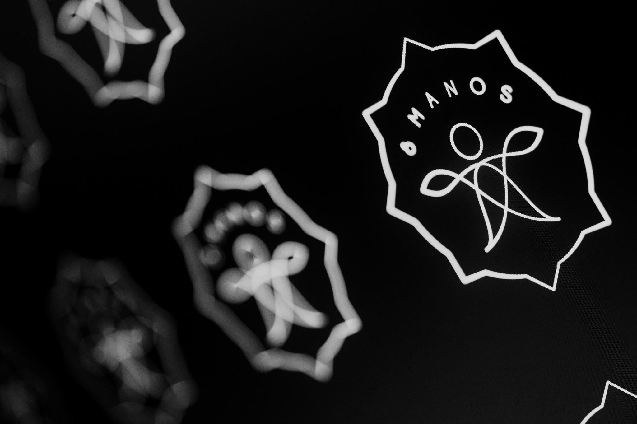 GD_8manos_logo_11